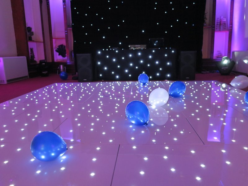 White LED dancefloor and starcloth drape